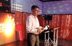 Mr. Philippe Luxcey speaking at Orange Expo 2012 in Kampala. Photo by Albert Mucunguzi