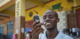 Electrical Student, Jean Louis Thomas writes a text message to a friend downtown Port-Au-Prince, Haiti, June 5, 2010.