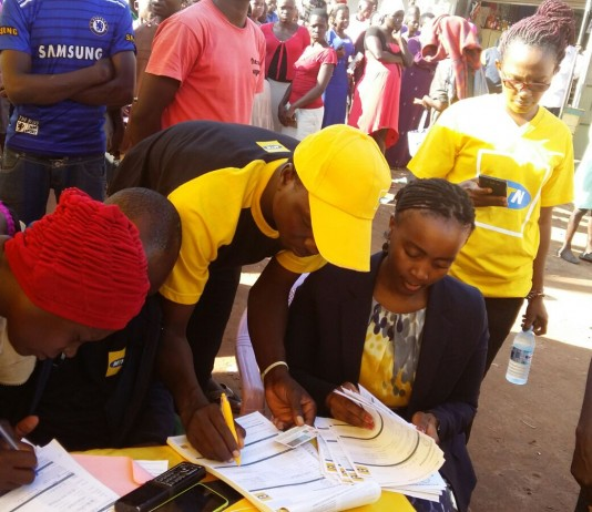 MTN's CMO Mapula Bodibe personally verifies registered customers in Luwero Kasana after the launch of ReadyPay Solar system in partnership with Fenix International.