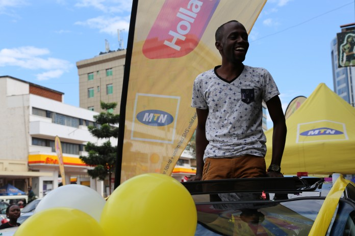 Ben Namanya rejoicing after being handed the KIA Sportage car yesterday.