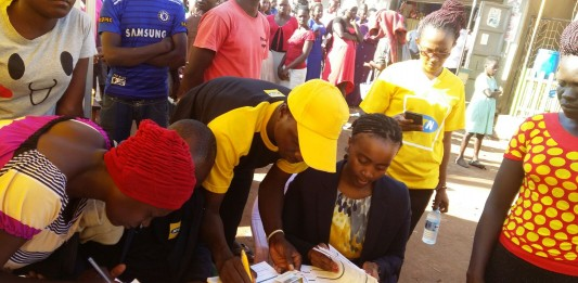 MTN's CMO Mapula Bodibe personally verifies registered customers in Luwero Kasana after the launch of ReadyPay Solar system in partnership with Fenix International earlier this month
