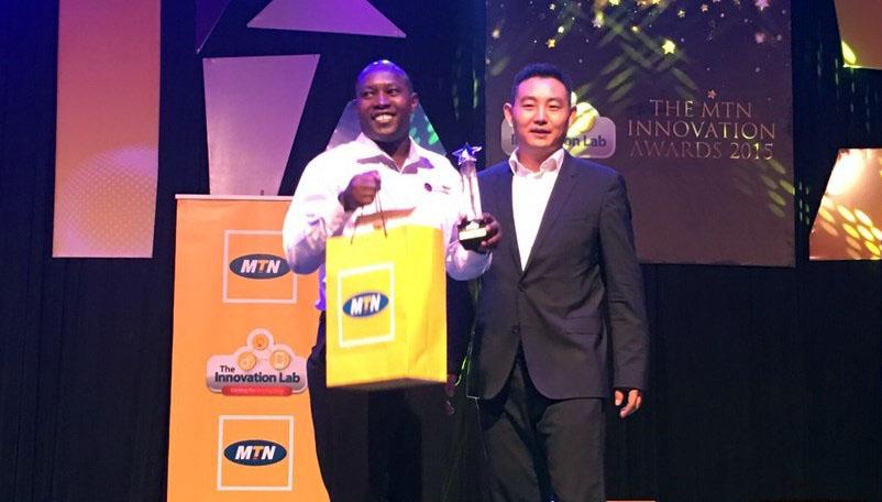 "Wilson Kutegeka receiving the ""Best Health Application"" award."