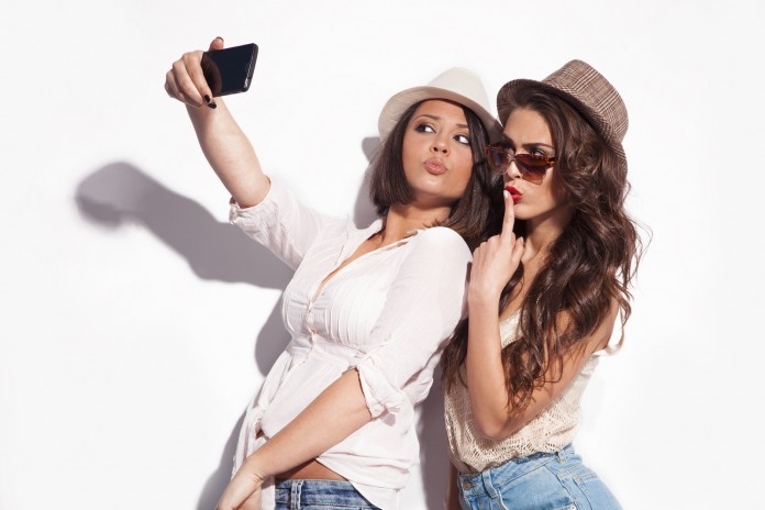 How to take a perfect selfie. The first step is: Be A Woman. Image Credit: PlayBuzz