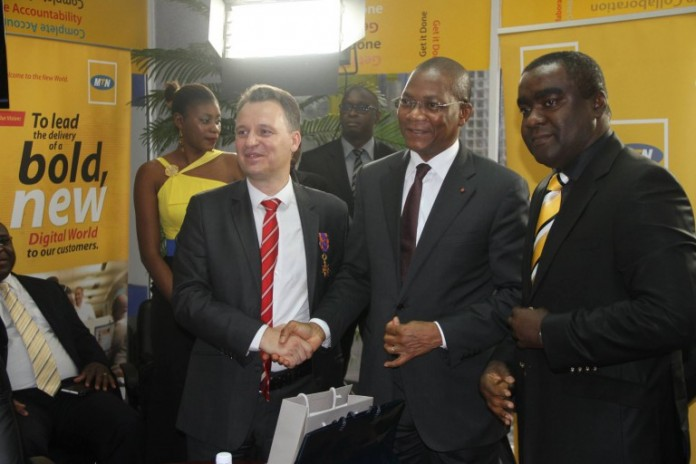 MTN officials at the handover of the partial payment in Côte d'Ivoire. Image Credit: rumeursdabidjan