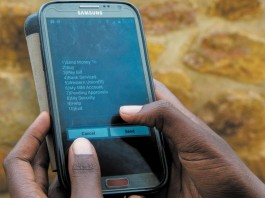 A client using the MTN Mobile Money platform. Image Credit: NewTimes