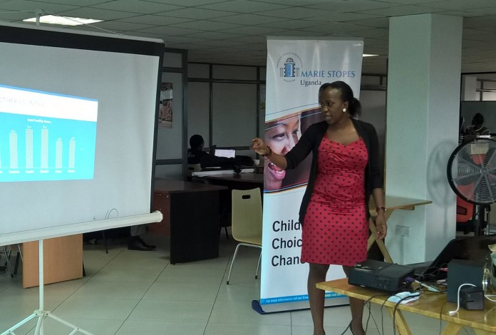 Faith Kyateka, the Hotline and PR specialist at Mariestopes Uganda addressing the gathering yesterday.