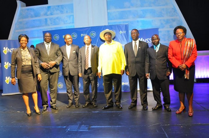 President Yoweri Kaguta Museveni poses with the NSSF board after delivering his speech at the 30 year anniversary dinner. Image Credit: NSSF