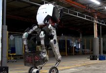 Boston Dynamics robot; 'HANDLE' is seen lifting a 100 lbs (pound) basket containing balls.