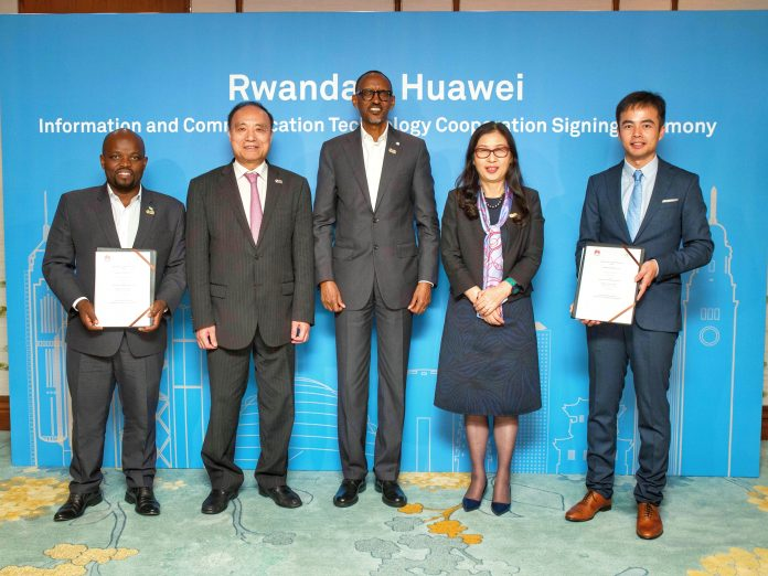 Rwanda President H.E. Paul Kagame (Center) and Huawei Chairwoman Ms. Sun Yafang Witnessed the Signing of MOU between Rwanda Government and Huawei with the Rwanda Minister of Youth and ICT Hon. Jean Philbert Nsengimana (Far Left), ITU Secretary General Mr. Zhao Houlin (2nd Left), and Huawei Rwanda Managing Director Mr. Stanley Chyn (Extreme Right). Photo Courtesy: Huawei