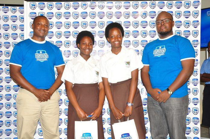 Stanbic Bank Regional Manager, Ronnie Muganzi with the winners from Mary Hill High School, on Saturday 18th March, 2017. Photo Courtesy: Stanbic Bank Uganda