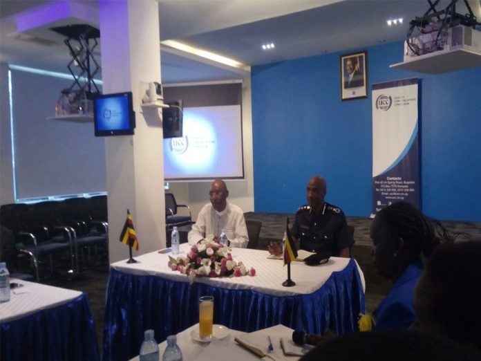 UCC Executive Director, Eng. Godfrey Mutabaazi with Inspector General of Police, Gen. Kale Kayihura meeting telecommunications operators on Friday morning.