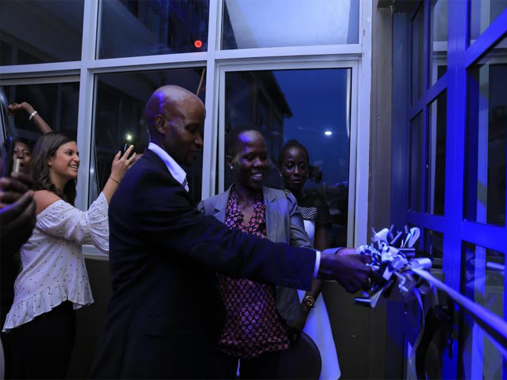 Constantine Mwesigye (Left - had the best driver rating of 4.6) and Lydia Igune (Right - most number of trips taken) seen cutting the ribbon during the launch of the 'Uber Greenlight Hub' in Kampala on Tuesday, 28th March, 2017. Photo Credit: Paul