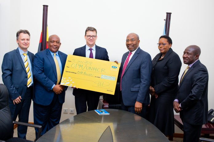 (L - R): Mr. Wim Vanhelleputte (MTN Uganda CEO), Mr. Charles Mbire (MTN Uganda Chairman), (Mr. Rob Shuter, MTN Group President and CEO), Rt. Hon. Dr. Ruhakana Rugunda (Prime Minister of Uganda), Ms. Felleng Sekha (MTN Group Chief Regulatory and Corporate Affairs Officer) and Mr. Ebenezer Twam Asante (MTN Group Vice President in charge of Southern and East Africa and Ghana (SEAGHA) Region) pose for a group photo.