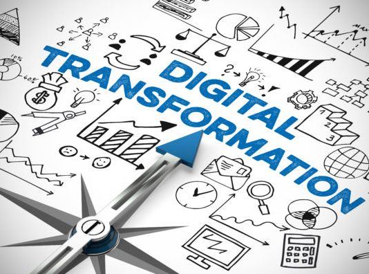 Digital business transformation as a concept on a compass with many symbols. (Image Credit: amadc)