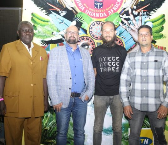 MTN Uganda Chief Marketing Officer; Olivier Prentout (2nd from left) poses with Derek Debru; Co-Founder of Nyege Nyege (black t-shirt), Uganda Tourism Board Executive Director; Steven Asiimwe (extreme left), and ; Talent Africa CEO (extreme right) at the MTN Nyege Nyege Festival launch at The Square Palace on Wednesday 21st, Feb 2018.