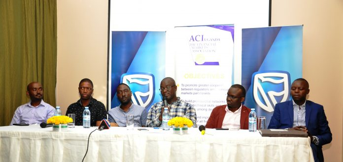 (L-R) Robert Mpunga; Head of Treasury at Bank of Africa, Faisal Bukenya; Head of Treasury at Exim Bank, Charles Katongole; Head of Markets at Standard Chartered Bank, Ronald Muyanja; Head of Trading at Citi Bank, David Wandera; Head of Markets at Barclays Bank and Hosea Akena; Head of Treasury at Eco Bank during a panel discussion at the ACI Financial Markets forum hosted by Stanbic Bank at the Sheraton Kampala Hotel.