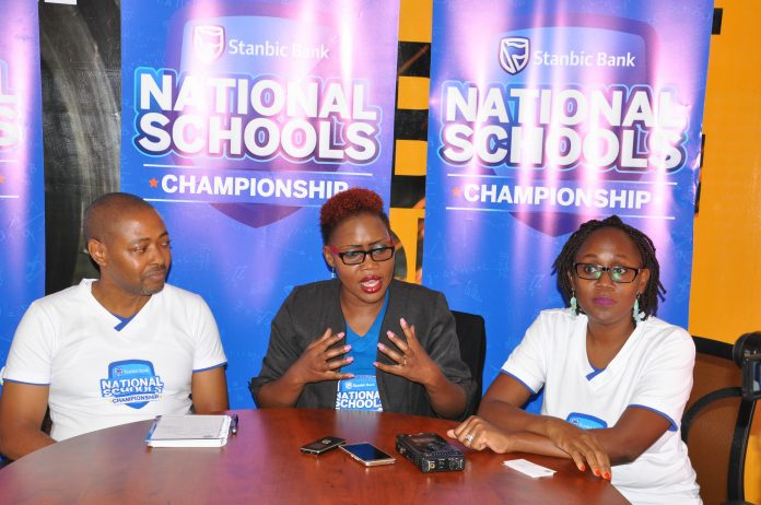 Barbara Kasekende; Stanbic Bank CSI Manager (center) briefing the press on the regional winners for the 2018 National School Championship challenge at their incubation space in Kololo on Friday 20th, Apirl 2018.