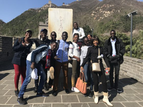 The 10 finalists for the 2018 Huawei's seeds for future programs pose for a group photo at the Great Wall of China, in Beijing.
