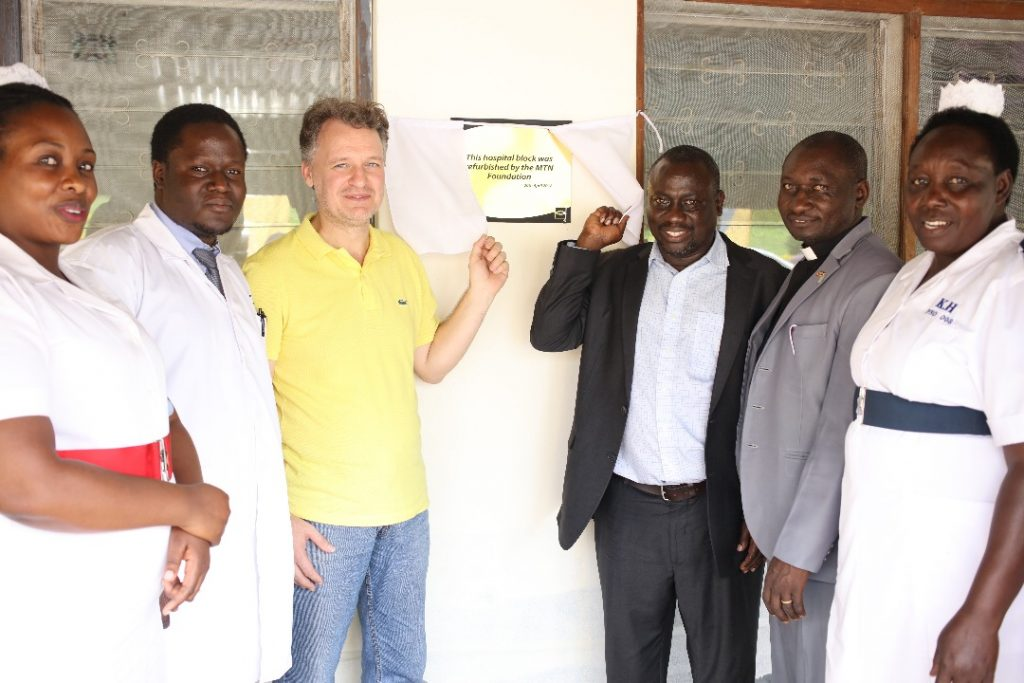 MTN Uganda's CEO, Wim Vanhelleputte poses with the staff hospital in front of the revamped Kabarole hospital on Friday 20th, April 2018.