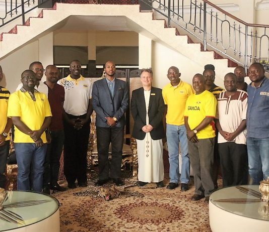 MTN Uganda's team led by CEO; Wim Vanhelleputte pose for a group photo with the King of Toro; His Royal Highness Dr. Rukirabasaija Oyo Nyimba Kabamba Iguru Rukidi IV at his palace.