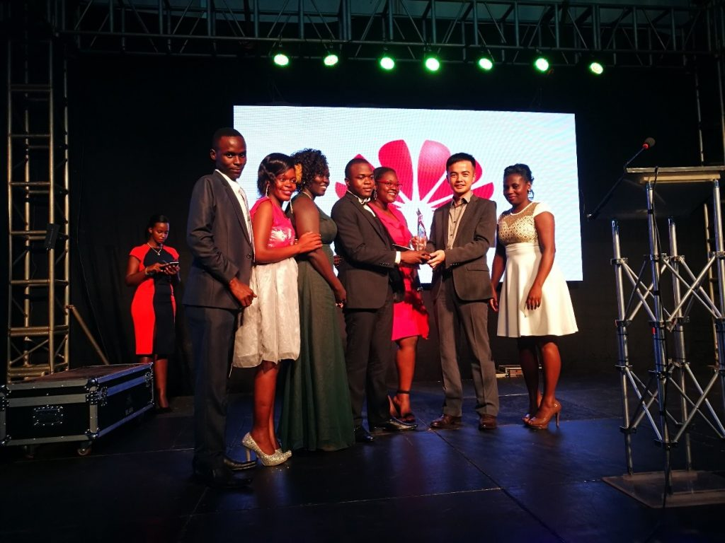 M-VOUCHER Team receiving an ICT for Development Award from the former Managing Director of Huawei Uganda Mr. Stanley Chyn at the UCC ACIA Awards 2017.