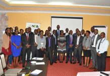 Uganda Bankers Association and NITA-U Officials pose for a picture.