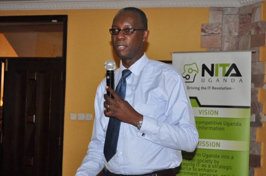 Wilbrod Humphreys Owor, Executive Director, Uganda Banker's Association, gives remarks during the meeting with NITA-U.