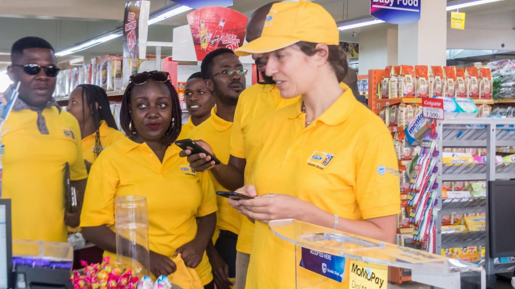 MTN Uganda's General Manager for Mobile Financial Services, Elsa Muzzolini paying for her products using MTN MomoPay at the Ntinda Shopping Centre in Ntinda after the re-launch of the service on Thursday 16th, August 2018.