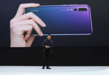 Richard Yu keynotes during the unveiling of the Huawei P20 and P20 Pro smartphones in Paris on March 21, 2018 (Photographer: Marlene Awaad/Bloomberg).