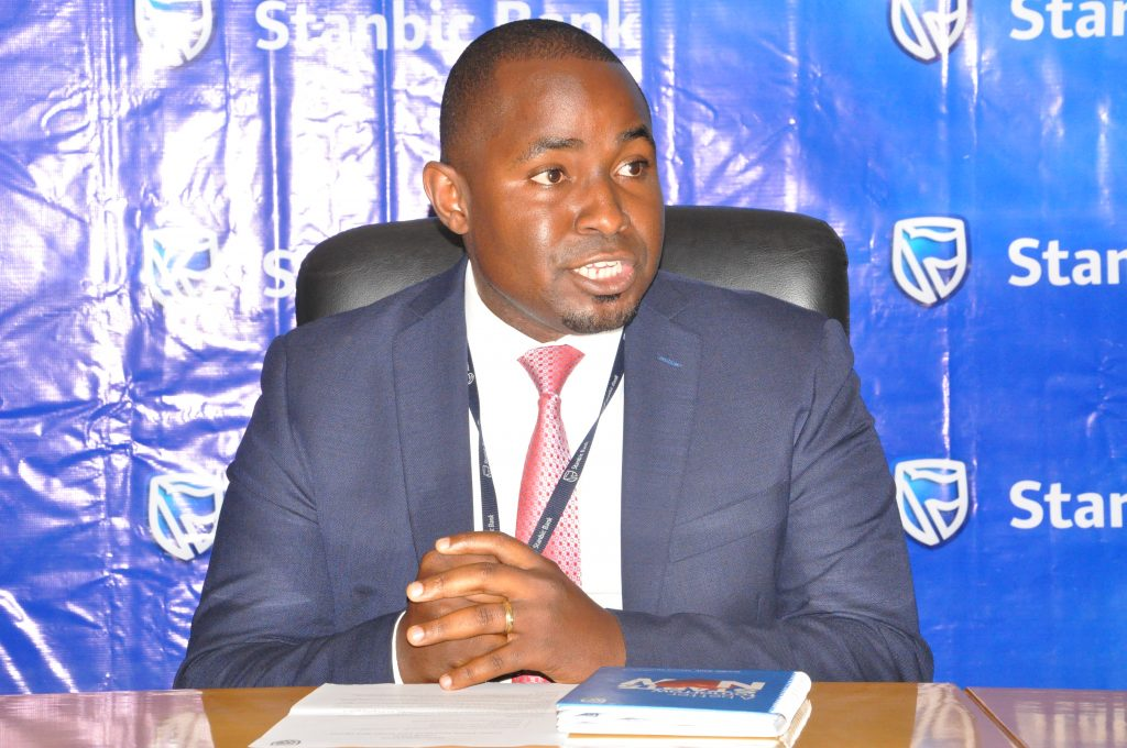 Stanbic Bank Head of Home Loans Jackson Emanzi addresses the media during the launch of Kyapa Loans partnership.