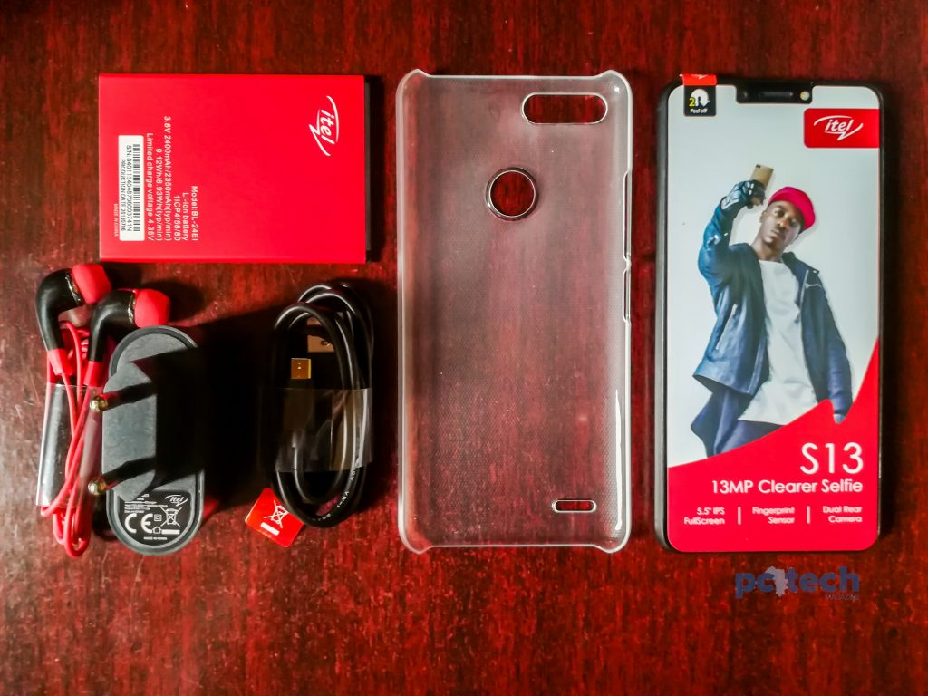 In side the box comes the itel S13 handset in a color unit of your choice, a removable 24000mAh Li-lon battery, a charging brick, a pair of red and black earphones, a USB data cable and charging chord.