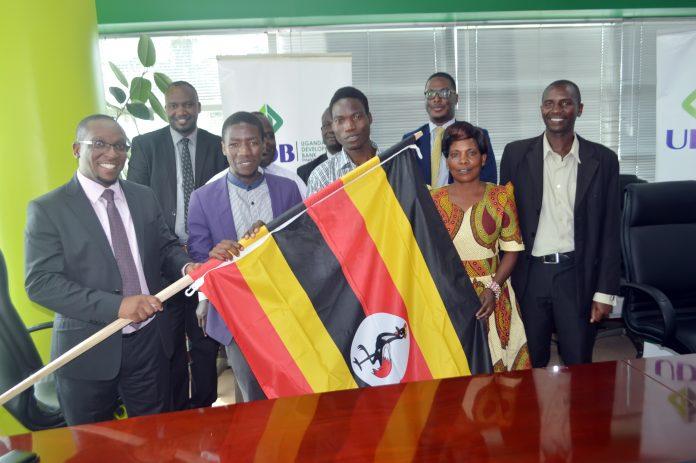 Allan Joshua Mwesigwa the Director Strategy & Corporate Affairs sending off Dalton Bakisuula and Martin Mugisha at the UDB offices in Kampala.