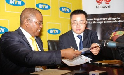 MTN CEO Themba Khumalo and VP Huawei Technologies exchange documents after signing of the Network Hand Over of the New MTN 3.5G Platform