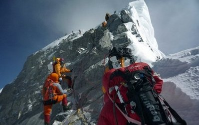 Climbers at the peak of Mount Everest