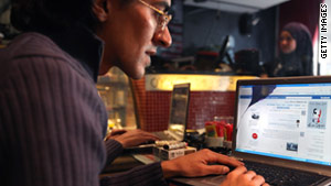 A cybercafe customer in Cairo, Egypt, looks at Facebook on Thursday, before widespread service outages.