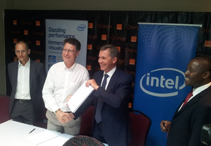 Orange CEO and Intel Corporation Vice President after signing the MOU in Kampala