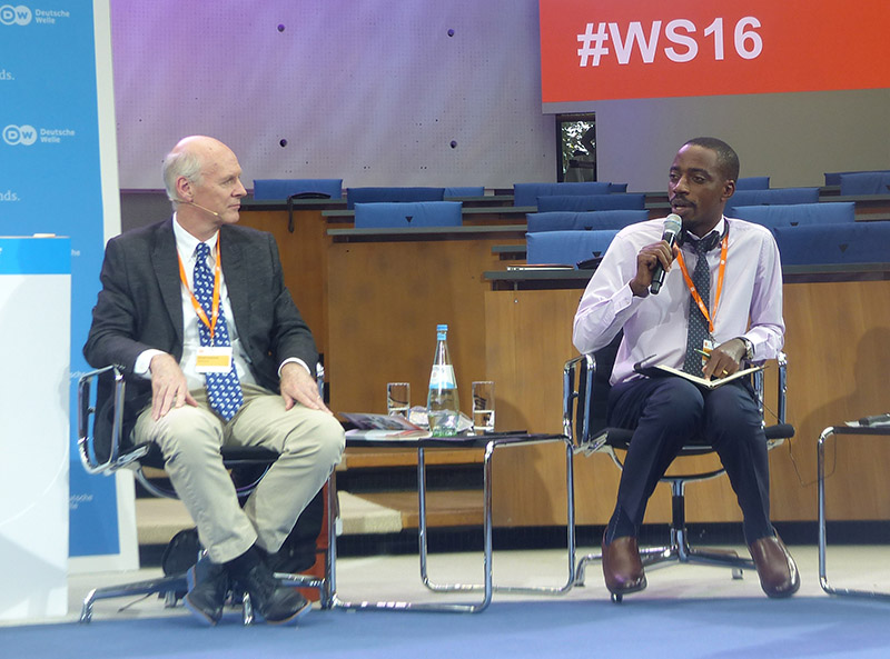 Albert Mucunguzi (right) speaking at the Panel Discussion