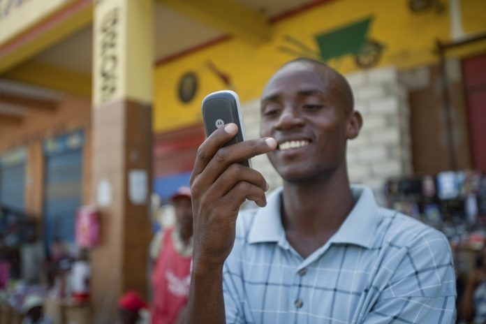 Electrical Student, Jean Louis Thomas writes a text message to a friend downtown Port-Au-Prince, Haiti, June 5, 2010.