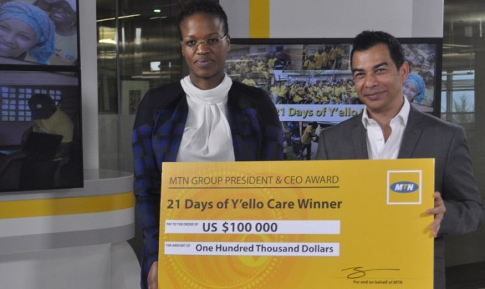 MTN Group Chief HR and Corporate Affairs Officer, Paul Norman hands over the 2015 Y'ello Care cheque to MTN Cameroon CEO, Philisiwe Sibiya