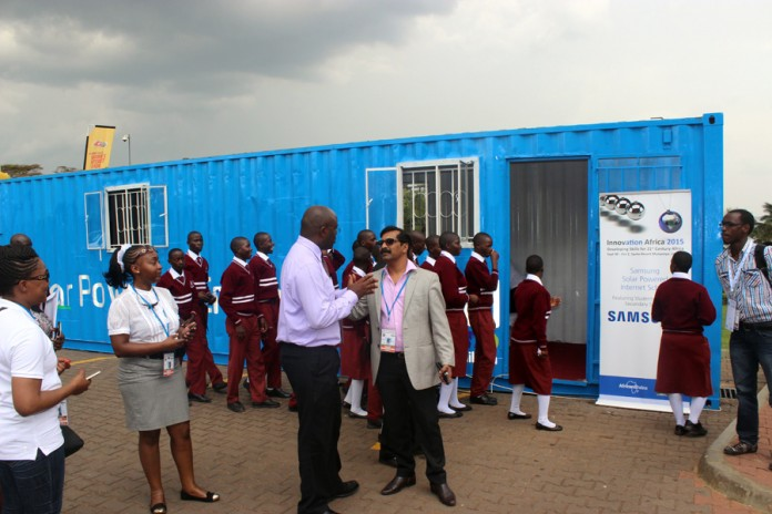 Samsung executives and Ministry of Education officials chatting after giving the media a demonstration of the Solar Powered Internet School