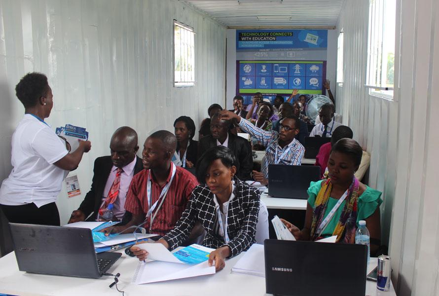 Journalists in the demo Samsung Solar Powered Internet School