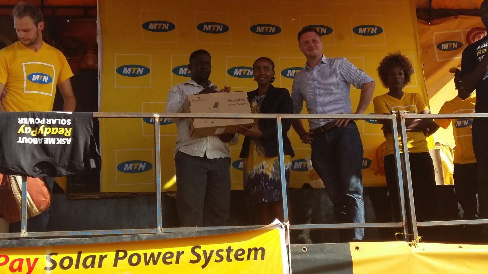 MTN's CMO Mapula Bodibe handing over a full ReadyPay Solar Kit to one of the winners from the draw that was conducted at the launch in Luwero-Kasana.