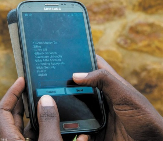 A client using the MTN Mobile Money platform. Image Credit: NewTimes