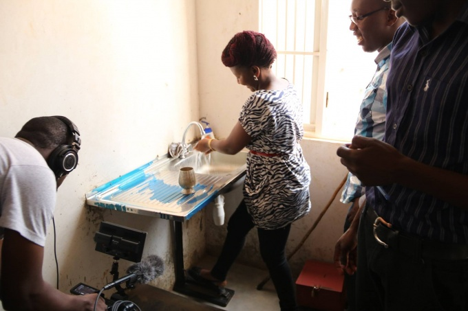 Entrepreneurs Demonstrate how a pedal tap operates. (Photo Credit: Resilient Africa Network).