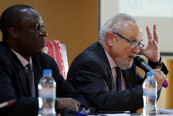 Dr. Cezar Alvarez Santos Senior IT FAO Rome and Technical Lead of the Project speaks at the meeting as FAO Representative in Rwanda, Attaher Maiga (L) looks on. (Photo Credit: New Times Rwanda)