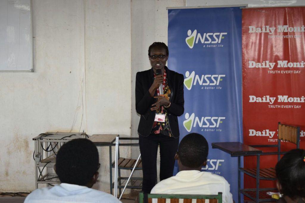Eunice Among, Head Corporate Communications Vodafone Uganda, inspiring Kampala International University students to ready themselves for internship and career opportunities, yesterday at the NSSF Career Expo. Vodafone's University Youth Programme supports, equips and empowers young people to handle and manage the working world.