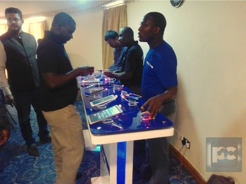 A journalist is seen taking a closer look at the phones during the launch on Friday, 10th March, 2017 at Golf Course Hotel in Kampala, Uganda.