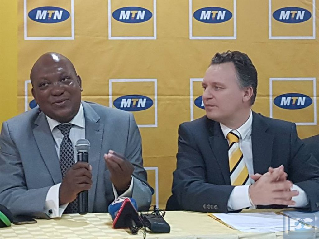 MTN Uganda CEO, Wim Vanehellepute (Right) looks at the Chairperson MTN Foundation Mr. George William Egadu during the press conference that was held on Monday March 6th at MTN Towers in Kampala.