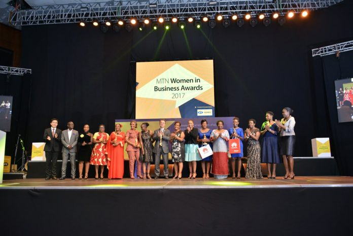 MTN CEO, Wim Vanhelleputte with the Winners, Judges, Panelists and Moderators of tonight's event #MTNWiB17. Photo Courtesy. MTN Uganda