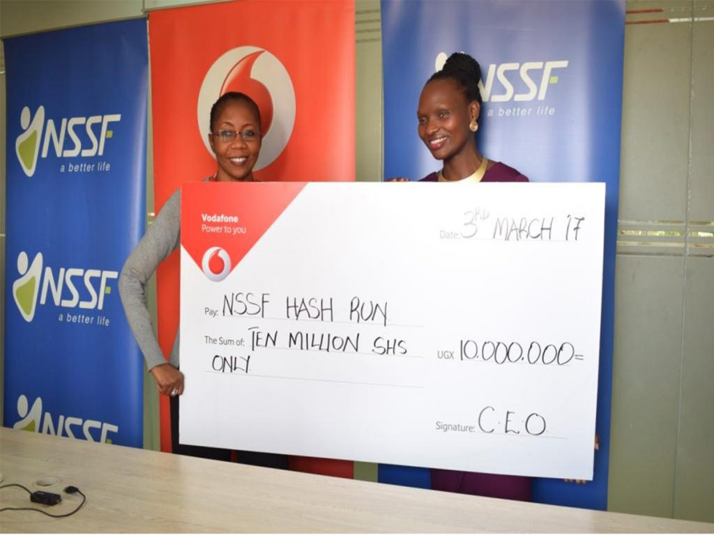 Vodafone Uganda Marketing Director, Ms. Progress Chisenga (left) handover dummy cheque worth Ugx10million to NSSF Marketing Director Barbara Teddy Arimi (right) at the NSSF offices recently towards the contribution of the second annual edition of the NSSF Kampala Hash Run which is scheduled to take place on Sunday 12th March, 2017.
